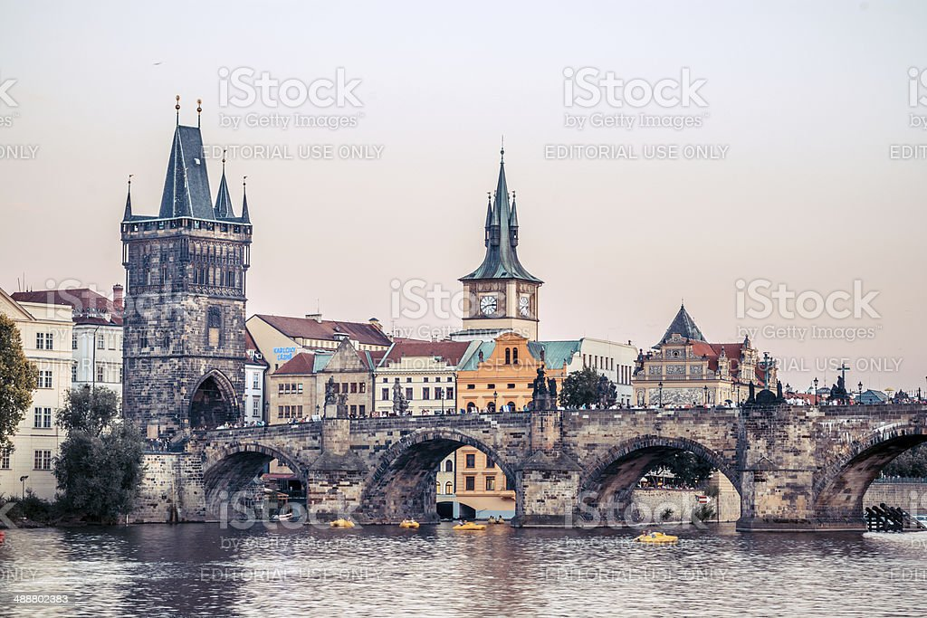 Charles Bridge and tower in Prague, Czech Republic at dusk stock photo