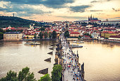 aerial view ofcharles bridge, vltava river, mala strana district and Prague castle at sunset in Prague
