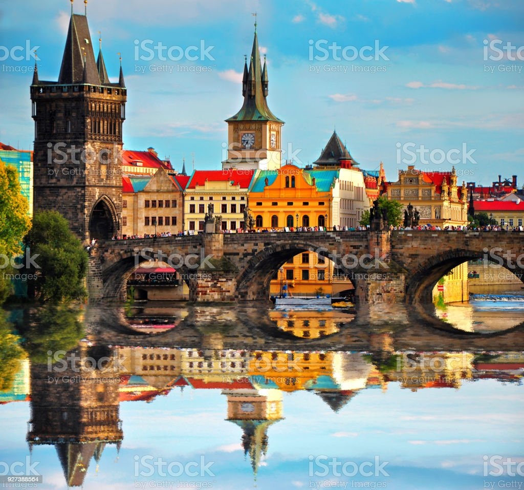 Charles bridge in Prague Czech Republic. Beautiful view of famous bridge, colorful architecture and Vltava river with reflection stock photo