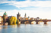 Cityscape of Prague with Charles Bridge in sunny, autumnal day (Czech Republic).
