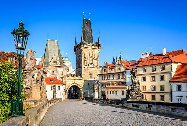 Charles Bridge, Prague, Czech Republic Prague, Czech Republic. Charles Bridge with its statuette, Lesser Town Bridge Tower and the tower of the Judith Bridge. prague stock pictures, royalty-free photos & images