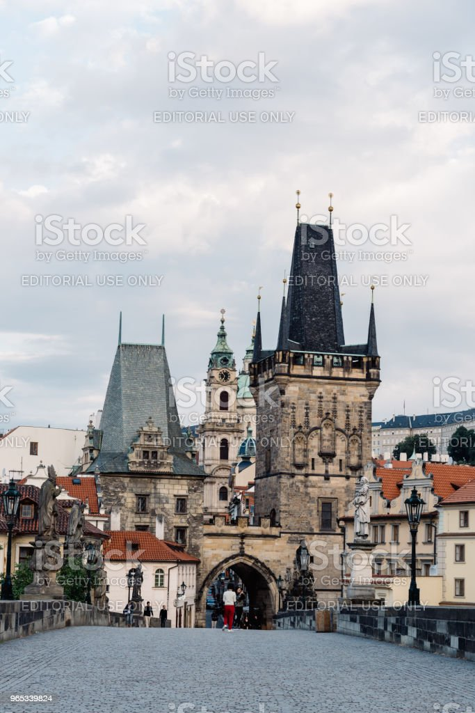 Charles Bridge with people against Prague Castle and sky royalty-free stock photo