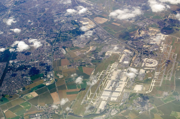 Charles de Gaulle airport, aerial view Aerial view of Charles de Gaulle in Paris, France on a sunny, summer day.  The smaller Le Bourget airfield is towards the top of the picture. urban sprawl stock pictures, royalty-free photos & images