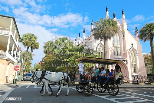 Charleston, South Carolina USA - October 12, 2015 Horse Drawn Carriage Ride by French Huguenot Church