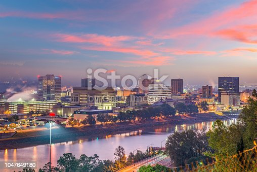 Charleston, West Virginia, USA skyline over the river at twilight.
