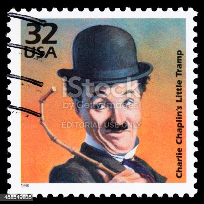 Sacramento, California, USA - March 19, 2011: A 1998 USA postage stamp with an illustration of Charlie Chaplin dressed as his Little Tramp character. Chaplin (1889-1977) first donned the Tramp's iconic clothes, hat, cane, and mustache in a 1914 film. Charles Chaplin and The Little Tramp are registered trademarks of Bubbles, Inc., S.A.