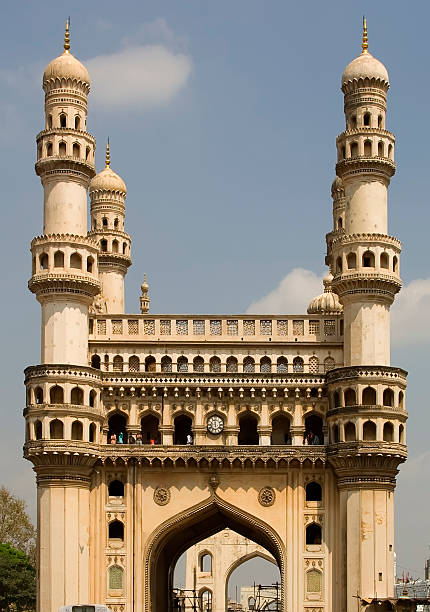 Charmiinar (Four Towers) This is the famous landmark called Charminar (the mosque of the four towers) in Hyderabad, India, built in 1591 the the Emperor Muhammad Qutb Shah to commemorate the eradication of plague. In later times it was used by the British Imperial authority as a warehouse for opium and liqueurs. The four minarets are said to represent the original four Caliphs of Islam. char minar stock pictures, royalty-free photos & images