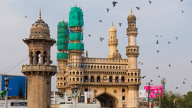 Charminar covered with nets for repair and restoration Hyderabad, Telangana, India, 28th Feb 2016: Famous charminar monument in hyderabad covered with nets as part of the repair and restoration process char minar stock pictures, royalty-free photos & images