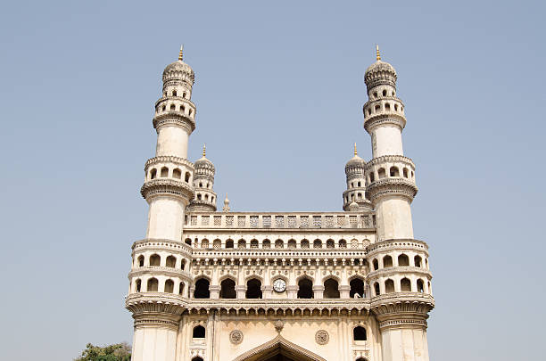 Charminar landmark, Hyderabad View of the top of the landmark Charminar tower in Hyderabad, India.  The famous structure was built in medieval times as an Islamic monument and is a symbol of the city. char minar stock pictures, royalty-free photos & images