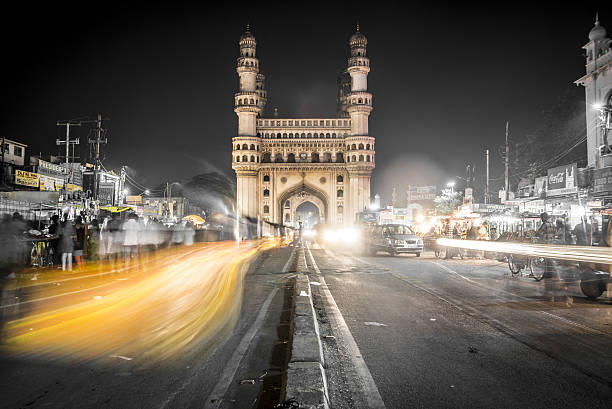 Charminar Mosque in Hyderabad, India The Charminar Mosque sits in the city center of Hyderabad and is one of Inida's most recognized structures. Tuk tuks and hand drawn cart zoom through the markets and street side restaurants. Tourists can climb to the top of the mosque and get a sweeping view of India's 5th largest city. char minar stock pictures, royalty-free photos & images