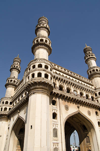 Charminar Tower angled view View looking up towards the top of Charminar tower in the centre of Hyderabad, India. The Mughal Empire era tower is the most recognised landmark in the city. char minar stock pictures, royalty-free photos & images