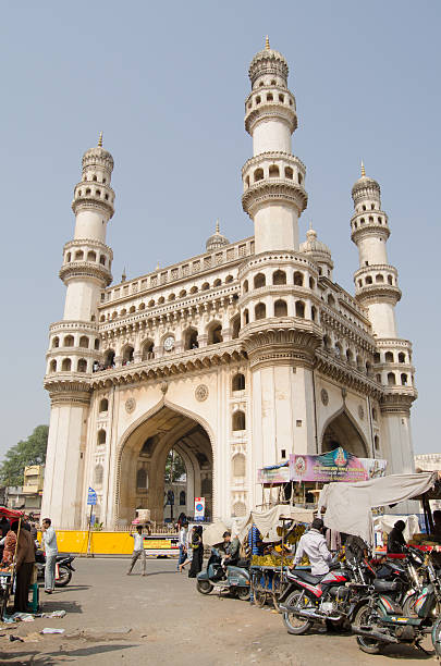Charminar Tower, Hyderabad Hyderabad, India - January 10, 2013: View through the busy market towards the landmark Charminar tower. char minar stock pictures, royalty-free photos & images