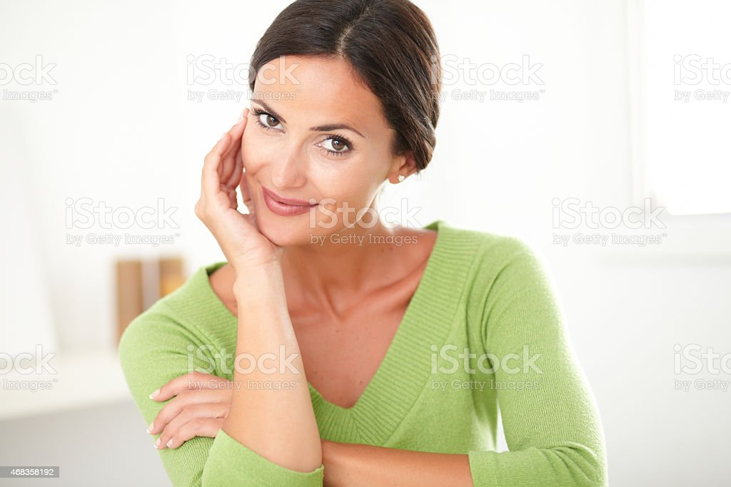 Charming adult woman smiling with satisfaction royalty-free stock photo