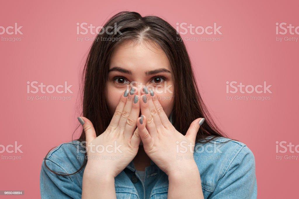 Charming amazed girl covering mouth zbiór zdjęć royalty-free