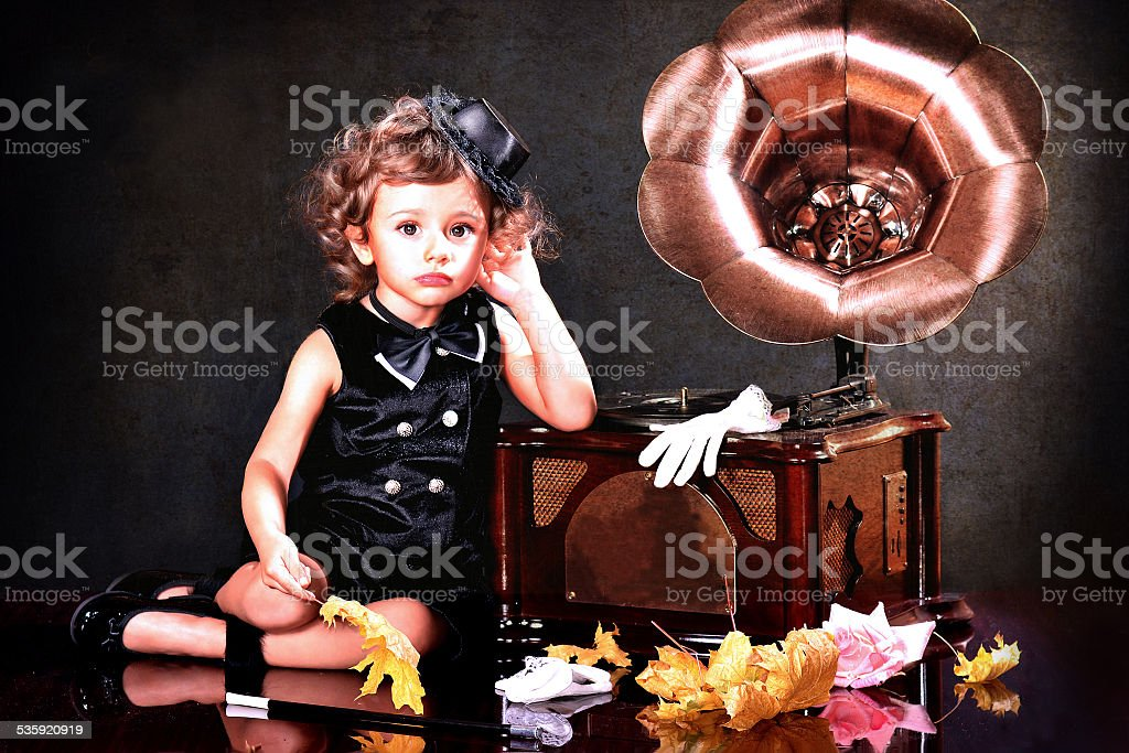 Charming baby listening to music stock photo