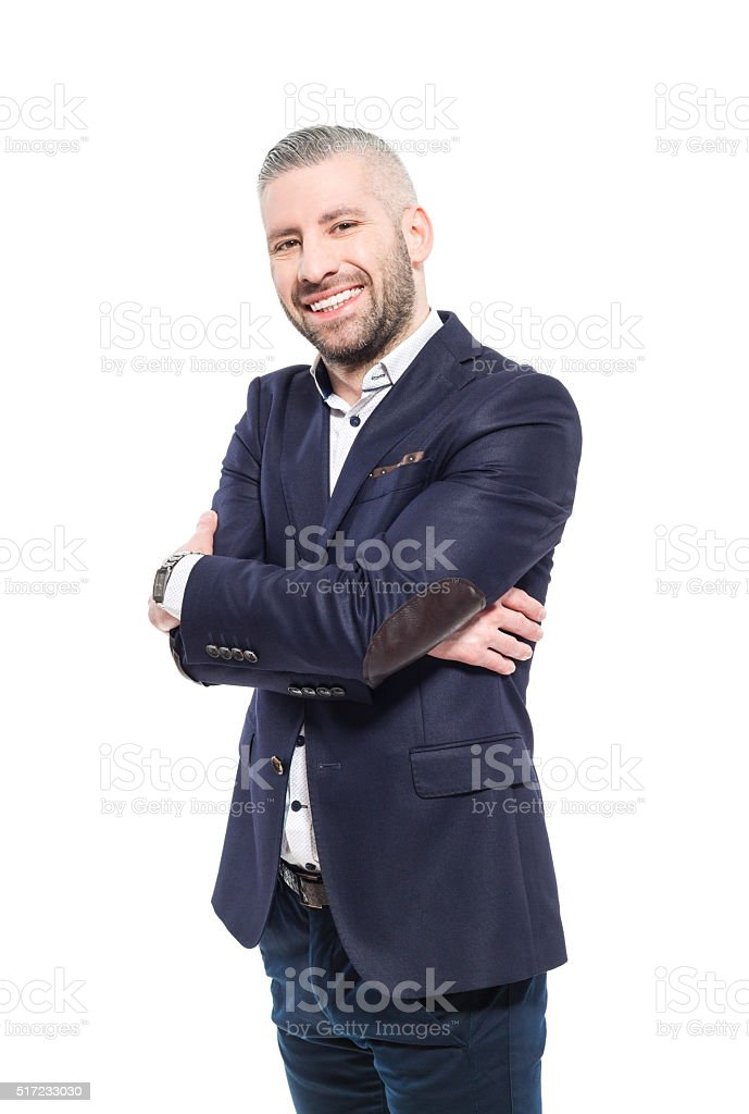 Charming bearded grey hair businessman, Studio Portrait Portrait of elegant bearded grey hair businessman wearing suit, smiling at camera. Studio shot, one person, isolated on white. Adult Stock Photo