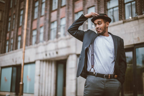 Charming black guy One man, Handsome young gentleman standing on the street downtown in city. suspenders stock pictures, royalty-free photos & images