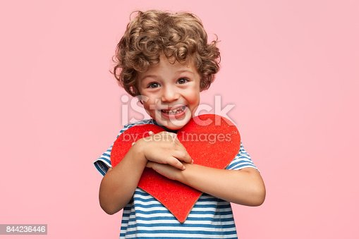 istock Charming boy posing with heart 844236446