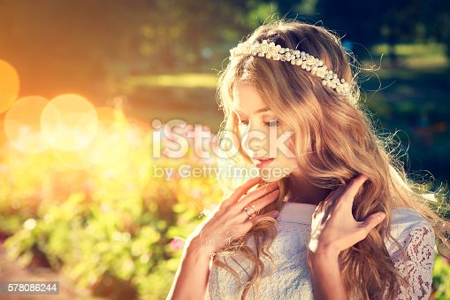 istock Charming Bride on Warm Nature Background 578086244