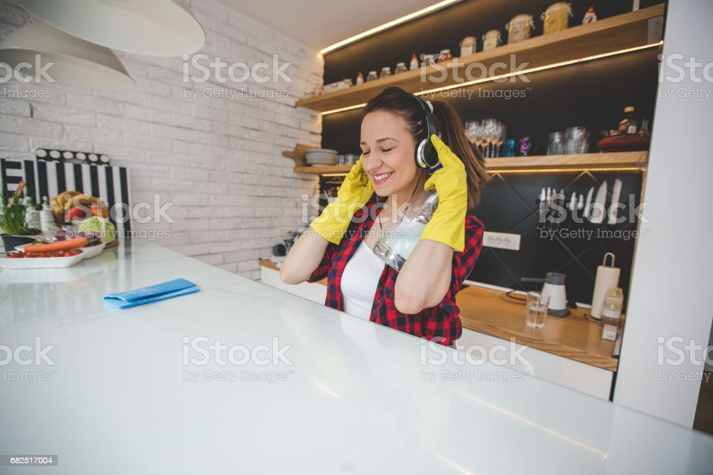 Charming brunette cleaning kitchen royalty-free stock photo
