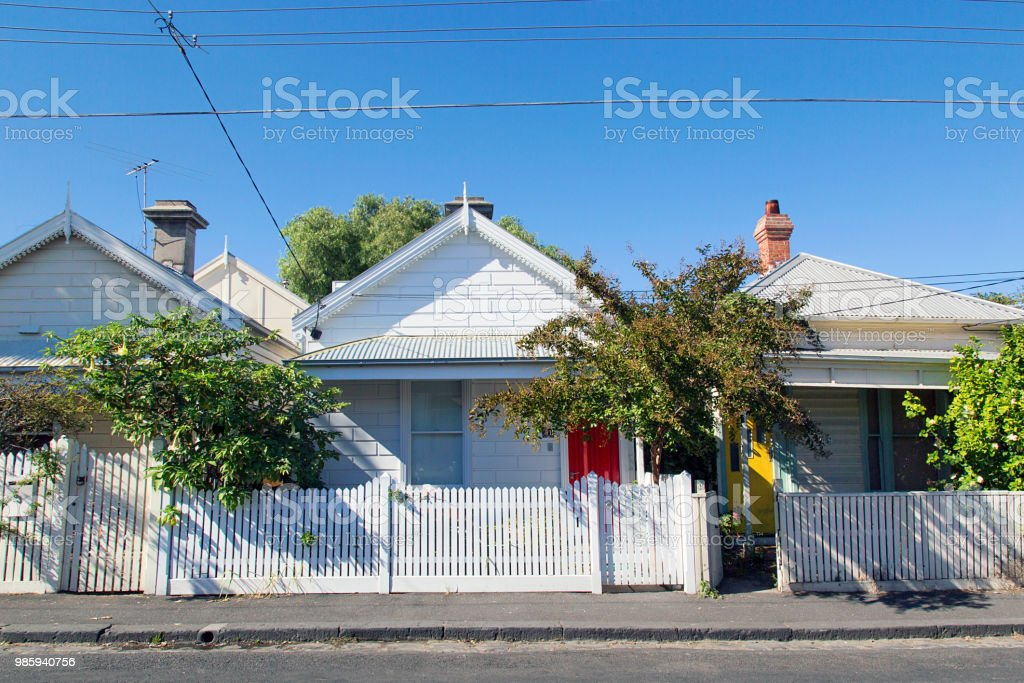 Charming bungalow homes with white picket fence. stock photo