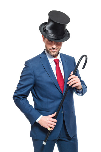 Charming Businessman Wearing Suit And Cylinder Hat Stock Photo - Download Image Now