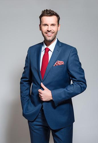 Charming Businessman Wearing Suit Studio Portrait Stock Photo - Download Image Now