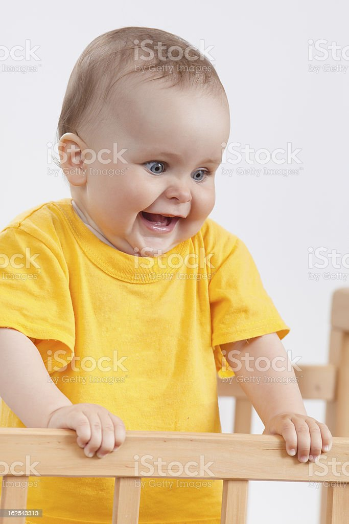 Charming child in the crib royalty-free stock photo