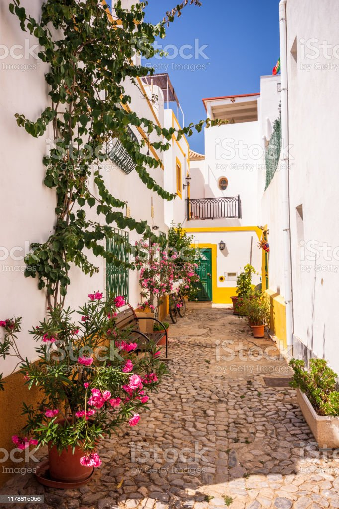 Charming cobblestone street in the whitewashed town of Tavira, Portugal - Royalty-free Algarve Stock Photo