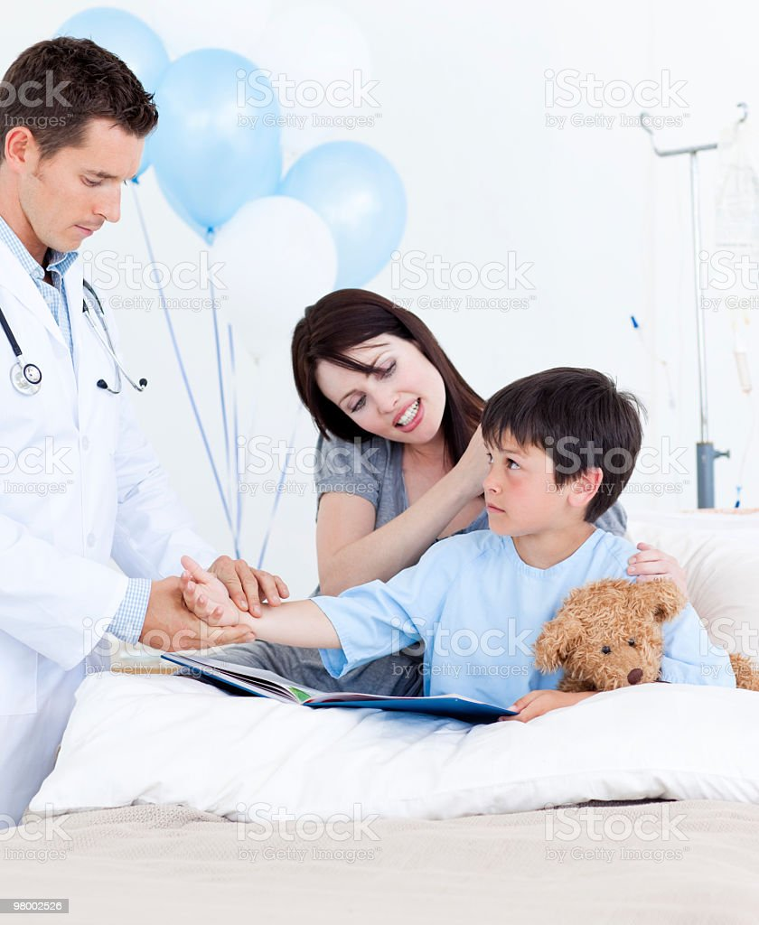 Charming doctor examining patient's arm royalty-free stock photo