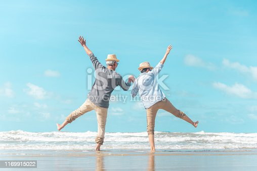 istock Charming elderly couple went to the beach to enjoy the sea breeze 1169915022