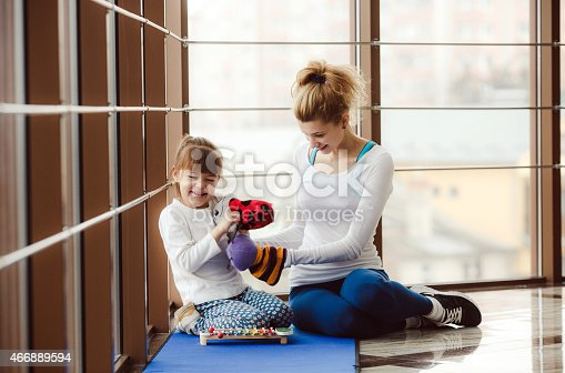 istock Charming family spends time in the gym 466889594