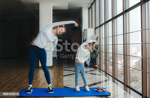 istock Charming family spends time in the gym 468450616