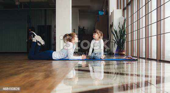 istock Charming family spends time in the gym 468450626