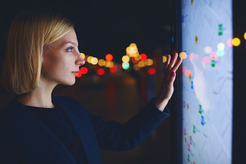 Charming Female Standing Front Big Digital Screen With City Map Stock Photo - Download Image Now