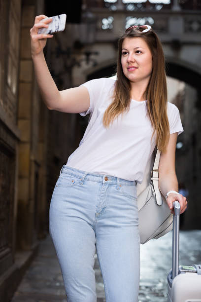 Charming female tourist making selfie stock photo