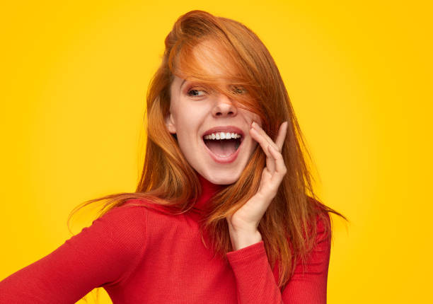 Charming ginger girl in red turtleneck stock photo