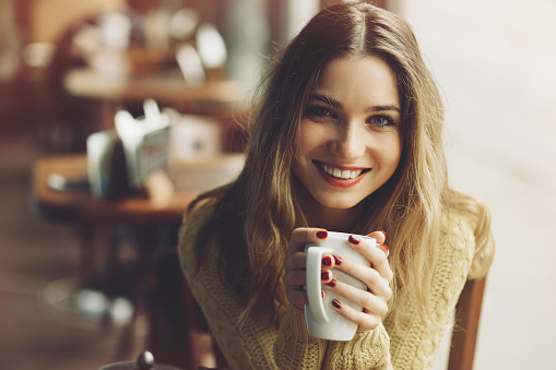 istock Charming girl drinking cappuccino and eating cheesecake 504536938