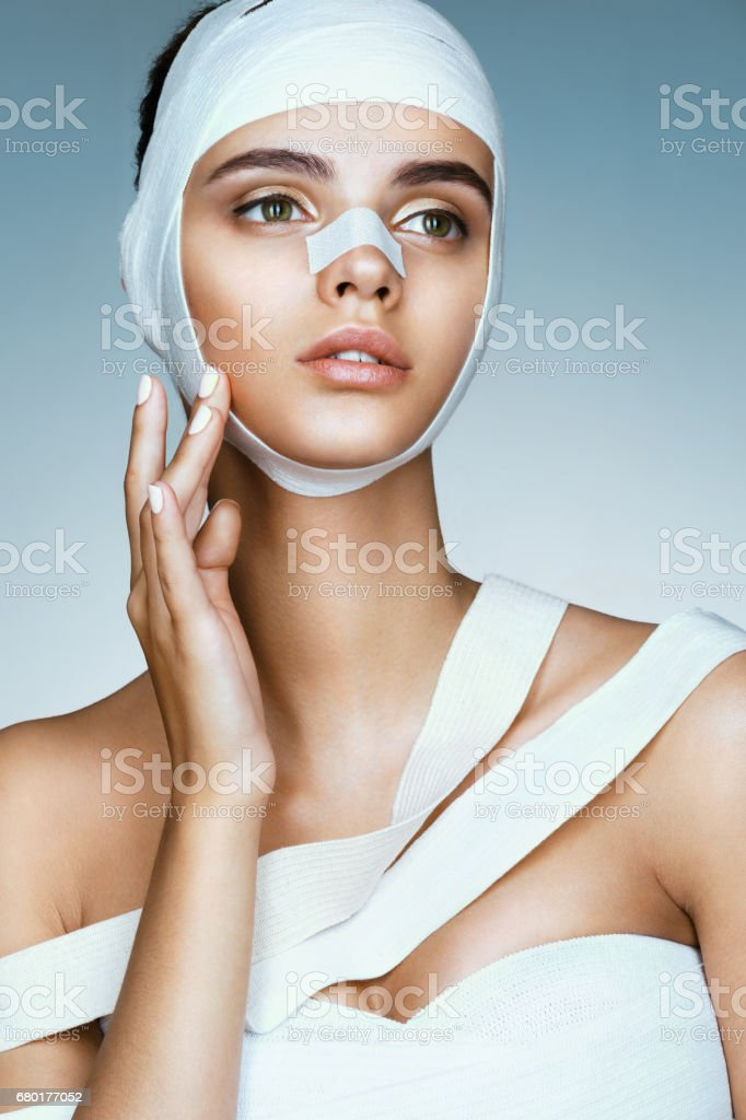 Charming girl removed medical bandages from her head. Portrait of...