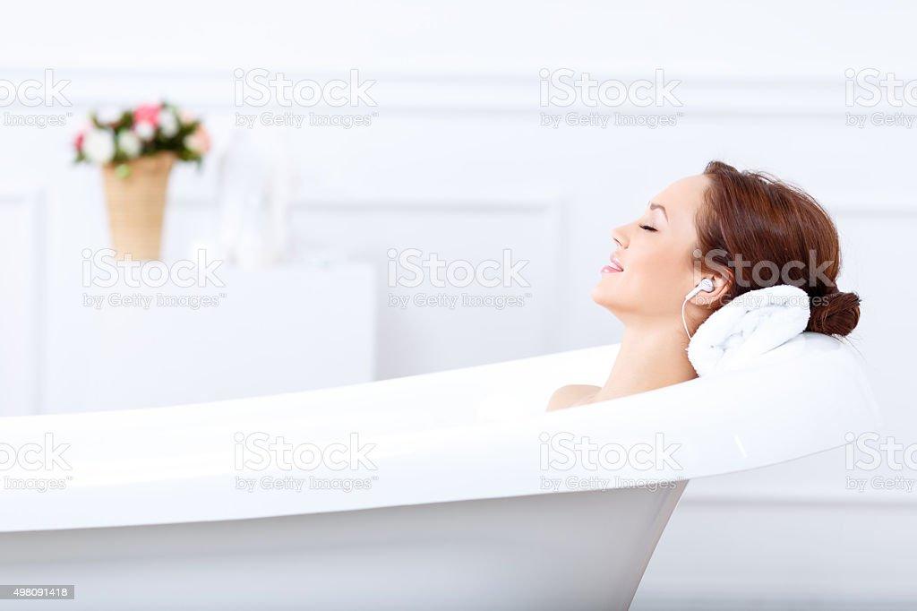 Charming girl taking a bath stock photo