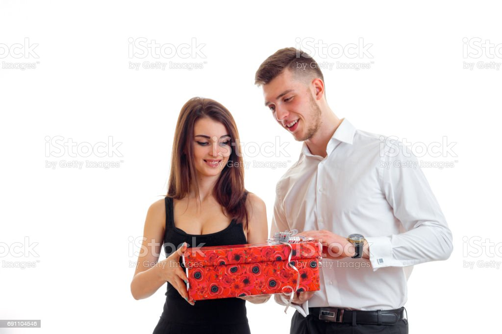 charming guy brought the girl to a huge gift and she is smiling stock photo