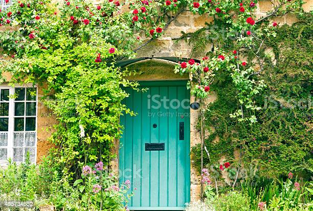 Charming house with green doors and red roses picture id495734652?b=1&k=6&m=495734652&s=612x612&h=90yarhc8 ome6kyqn60kmtm6xvn9vjstcskg3opktqe=