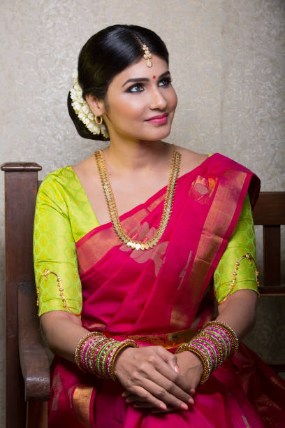 charming Indian model in traditional saree bride attire stock photo