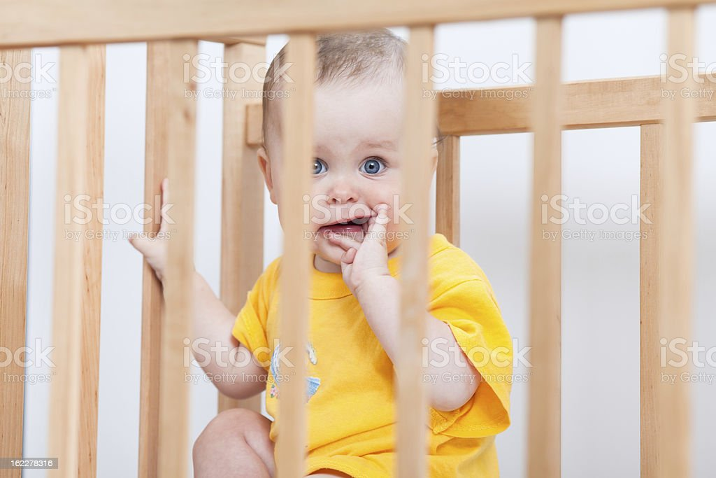 Charming kid in the crib royalty-free stock photo