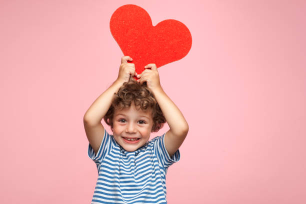 Charming kid posing with heart - foto stock