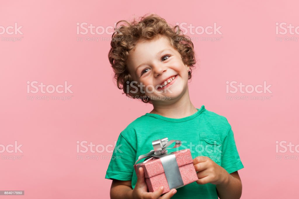 Charming kid with gift box stock photo