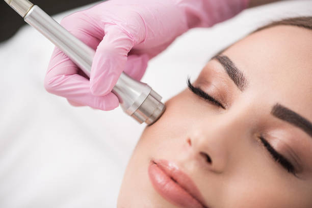 charming lady is getting cosmetic treatment in spa - beauty treatment stock photos and pictures