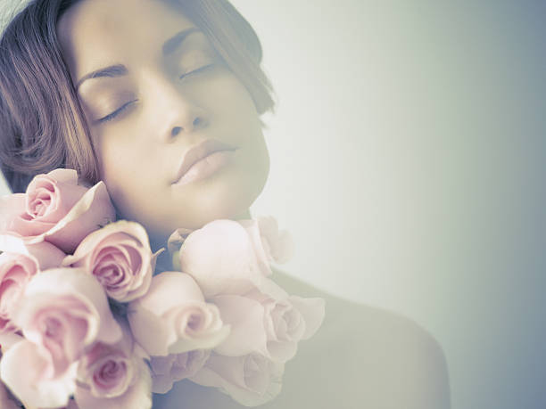 Charming lady with roses stock photo