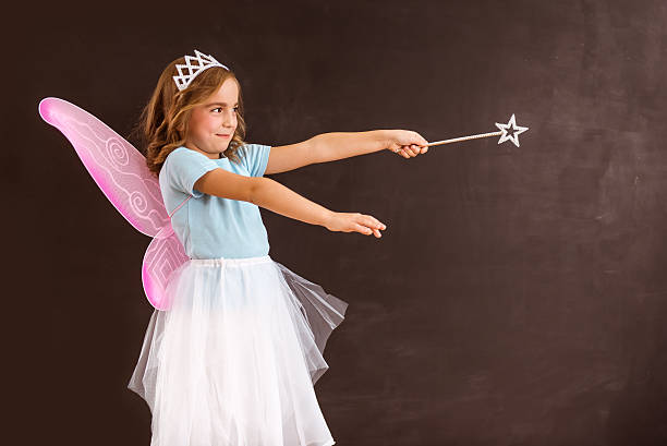 charming little fairy - fairy wand stock photos and pictures