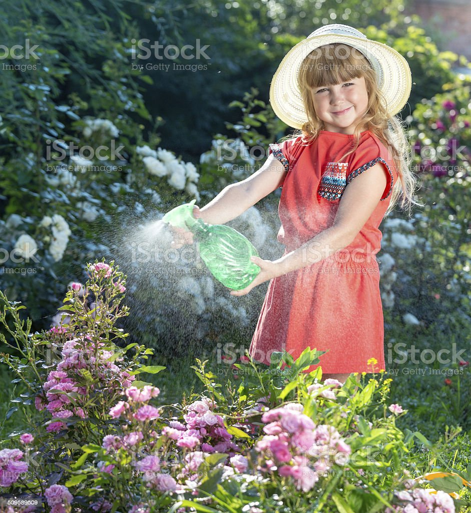 Charming little flower grower royalty-free stock photo